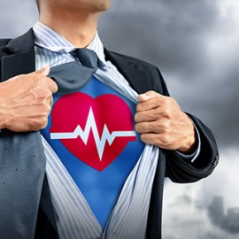 businessman in superhero costume with heartbeat